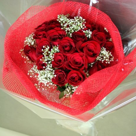 W Flowers product: 24 red roses wrapped in mesh