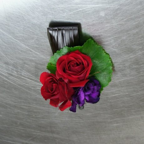 W Flowers product: Boutonniere in red and purple
