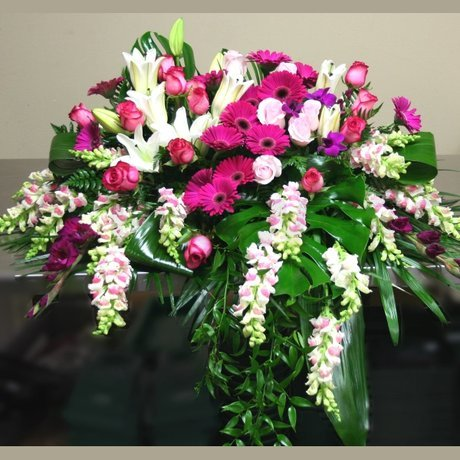 W Flowers product: Casket Spray In Loving Memory