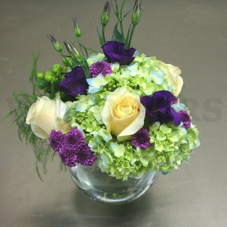 W Flowers product: Centerpiece in purple white and green
