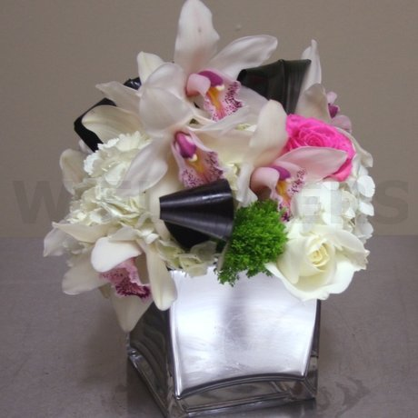 W Flowers product: Centerpiece with White Hydrangea and Cymbidium Orchid