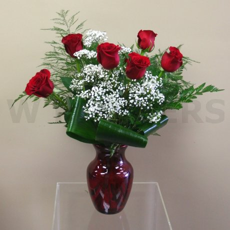 W Flowers product: Classic Six red roses in a red vase
