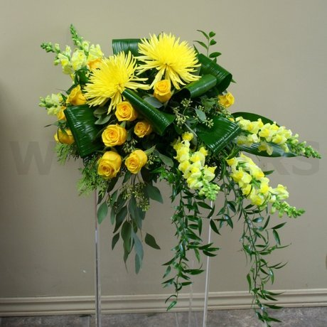 W Flowers product: Flowers for top of casket in yellow