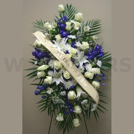 W Flowers product: Funeral flowers in white and blue