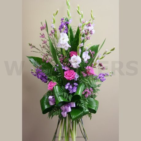W Flowers product: Funeral Standing Spray in Lavender Color