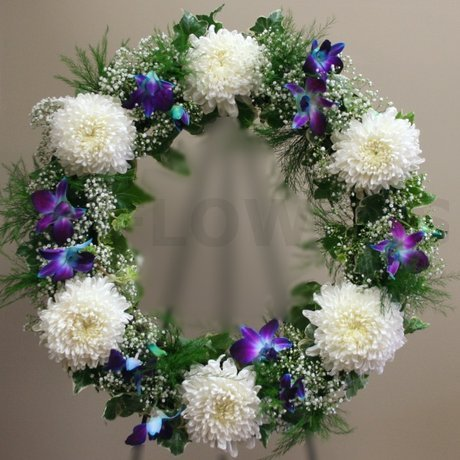 W Flowers product: Funeral Wreath in white and blue flowers