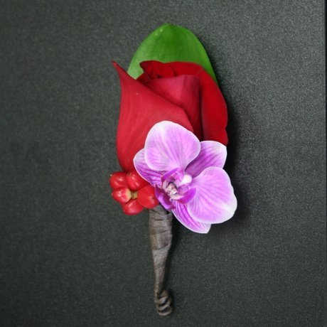W Flowers product: Groom's Boutonniere in fuchsia and red