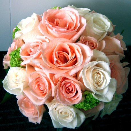 Classic bridal bouquet in soft colors of peach ivory and lime green