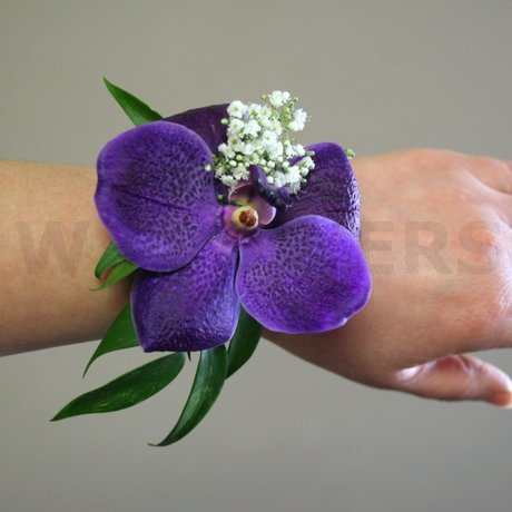 W Flowers product: Purple orchid wristlet