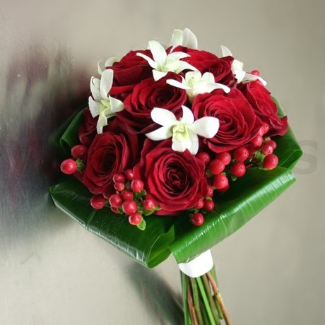 W Flowers product: Wedding Bouquet with White Orchids and Red Berries
