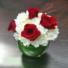 W Flowers product category: White Hydrangea and Red Roses Centerpiece